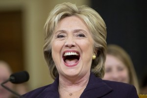 "Democratic presidential candidate and former Secretary of State Hillary Rodham Clinton, laughs out loud after Rep. Martha Roby, R-Ala., asked Clinton if she was home alone during night of the 2012 Benghazi attacks during testimony on Capitol Hill in Washington, Thursday, Oct. 22, 2015, before the House Select Committee on Benghazi. After laughing out loud, Clinton said it was a bit of levity at 7:15 p.m., more than nine hours since the hearing began. She described conversations with other officials and said, ""I did not sleep all night."" (AP Photo/Jacquelyn Martin)"